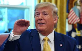 US President Donald Trump speaks after announcing an initial deal with China while meeting the special Envoy and Vice Premier of the People's Republic of China Liu He at the Oval Office of the White House in Washington, DC on October 11, 2019. -