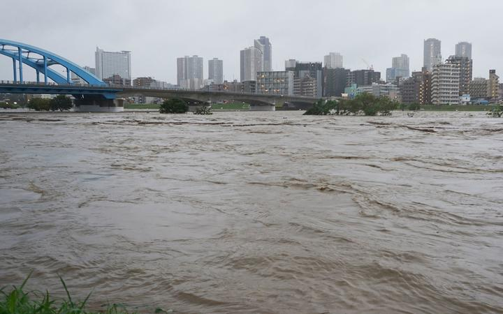 Swollen water levels along Tama river are pictured after heavy rains brought by approaching Typhoon Hagibis hit the Tokyo area on October 12, 2019.