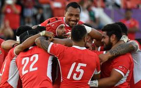 Tonga's players celebrate winning the Japan 2019 Rugby World Cup Pool C match between the United States and Tonga at the Hanazono Rugby Stadium.