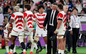 Japan players and coach Jamie Joseph celebrate their win over Scotland which qualified them for the RWC quarter-finals 2019