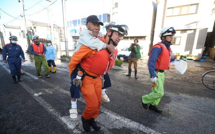 Firefighters conduct rescue operation in Motomiya City, Fukushima prefecture on Oct. 13, 2019, one day after Typhoon No. 19, known as Typhoon Hagibis, a powerful super typhoon, made a landfall.
