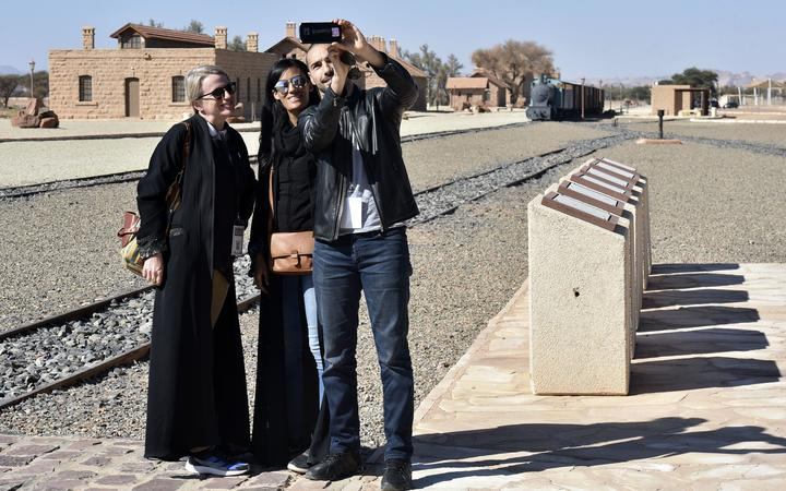 A picture taken on January 4, 2019, shows a people visiting the Hejaz train station near Saudi Arabia's northwestern town of al-Ula, an Ottoman era railway.