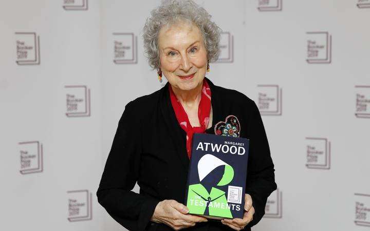 Canadian author Margaret Atwood poses with her book'The Testaments that won her the 2019 Booker Prize for Fiction