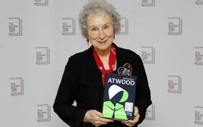 Canadian author Margaret Atwood poses with her book 'The Testaments' that won her the 2019 Booker Prize for Fiction