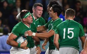 Ireland's number 8 CJ Stander (L) reacts after scoring a try  during the Japan 2019 Rugby World Cup Pool A match between Ireland and Samoa