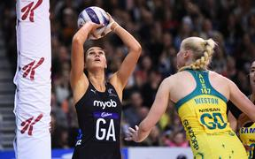 Silver Ferns player Ameliaranne Ekenasio shoots against Australian Diamonds.