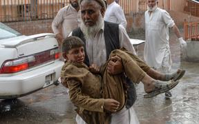 A volunteer carries an injured youth to hospital, following a bomb blast in Haska Mina district of Nangarhar Province on October 18, 2019. -