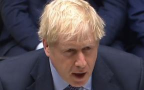 A video grab from footage broadcast by the UK Parliament's Parliamentary Recording Unit (PRU) shows Britain's Prime Minister Boris Johnson
