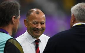 England's head coach Eddie Jones (C) smiles during a warm-up session before the Japan 2019 Rugby World Cup quarter-final match between England and Australia at the Oita Stadium in Oita on October 19, 2019. (Photo by CHARLY TRIBALLEAU / AFP)