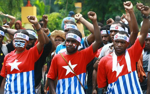 Papuan students take part on a rally in Surabaya, East Java province, in December 2013, demanding the freedom of West Papua province.