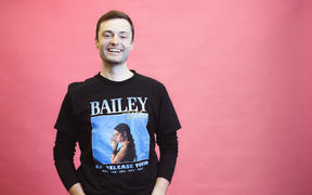 Host of RNZ podcast The Detail, Alex Ashton in his Bailey Wiley t-shirt