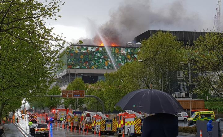 Flames and smoke coming from the roof of the convention centre this morningPhoto:RNZ / Liu Chen