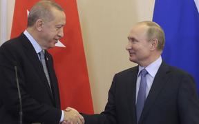 Russian President Vladimir Putin (R) and his Turkish counterpart Recep Tayyip Erdogan shake hands during a joint press conference following their talks in the Black sea resort of Sochi on October 22, 2019.