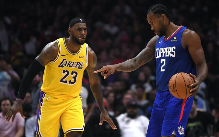 Lebron James (L) of the Los Angeles Lakers and Kawhi Leonard of the Los Angeles Clippers in the LA derby on opening night of the 2019/20 NBA season.