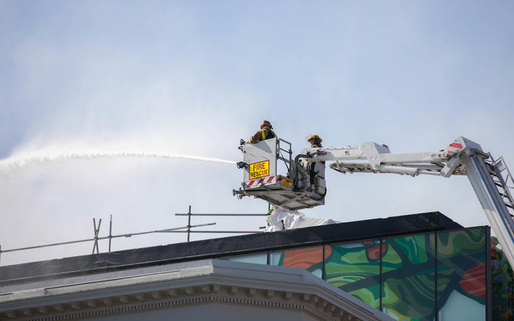 Firefighters douse the blaze on Tuesday.
