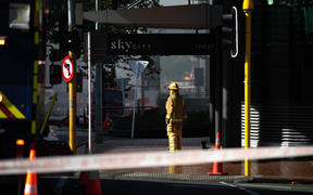 A firefighter outside the Sky City complex on day two of the fire.