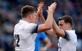 England's Owen Farrell celebrates with George Ford.