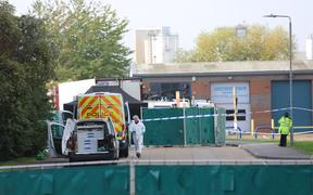 Police work at the industrial park in Essex where 39 bodies were discovered in the back of a lorry on 23 October.