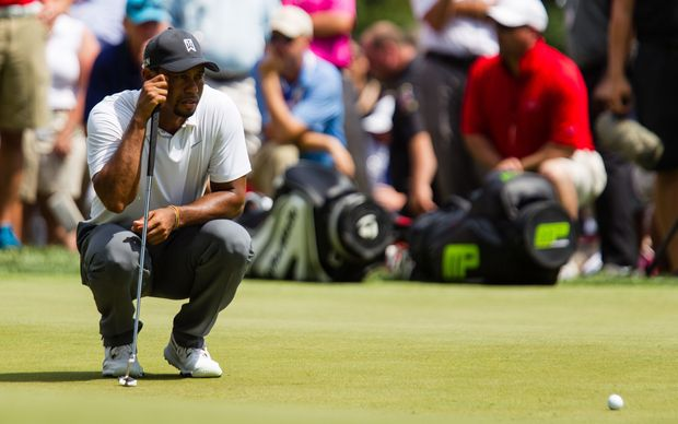 Tiger Woods lines up his putt on 9 during the second round of the Quicken Loans National at Congressional Country Club in Bethesda, MD. 2014.