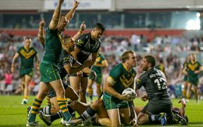 Australia rugby league team celebrates a try against the Kiwis.