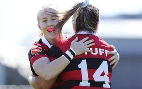 Becky Davidson of Canterbury is congratulated by Kendra Cocksedge (L) after scoring a try. Farah Palmer Cup.