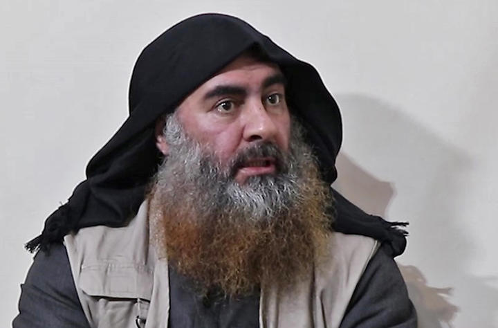 (FILES) In this file photo taken on April 30, 2019 In this undated tv grab taken from a video released by Al-Furqan media, the chief of the Islamic State group Abu Bakr al-Baghdadi purportedly appears for the first time in five years in a propaganda video in an undisclosed location.