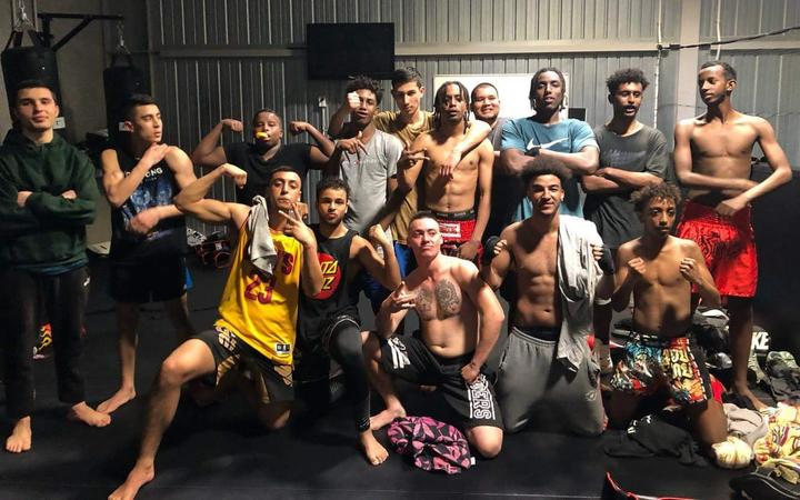 A group of young New Zealand men after a mixed martial arts training session.