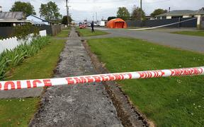 The police cordon around the area where an 8-year-old died in Otautau.