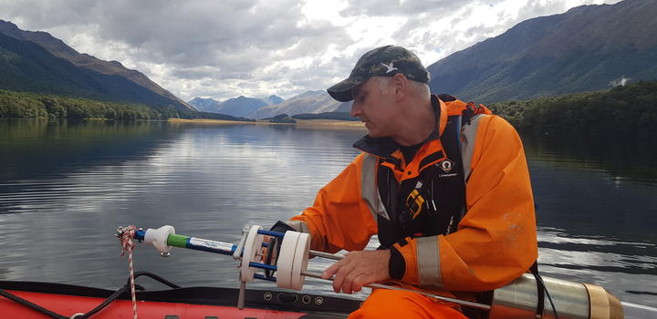 Marcus Vandergoes with the sediment corer, South Mavora Lake, Southland.
