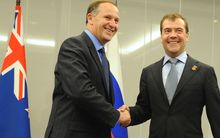 John Key shakes hands with Dmitry Medvedev at a bi-lateral meeting in Japan after trade talks started in 2010.