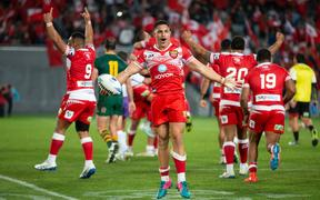 Tonga celebrates their win against Australia at the final whistle, during the rugby league match between the Australian Kangaroos and Tonga Invitational XIII at Eden Park, Auckland.  02 November  2019