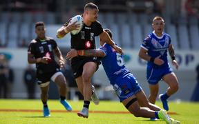 Fiji centre Brayden Williame, takes on the Toa Samoa defence during their recent rugby league test.