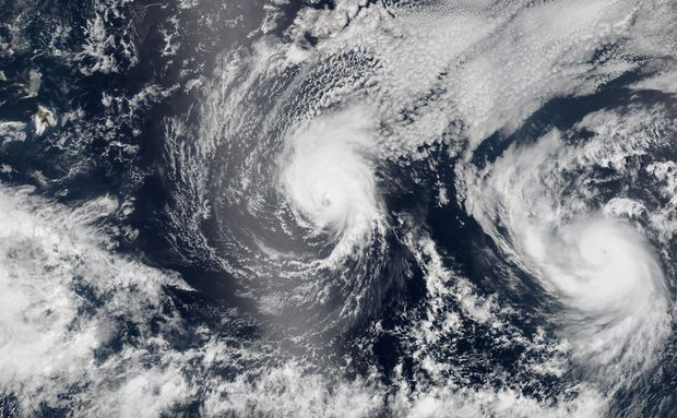 NASA Rarth Observatory image shows on August 5, both Iselle (L) and Hurricane Julio (R) en route to Hawaii.