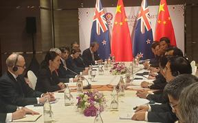 NZ and China at a bi-lateral at the East Asia Summit.