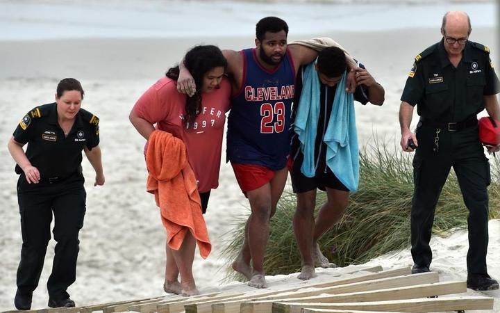 Relief at rescue as four pulled from rip