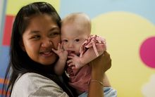 Thai surrogate mother Pattaramon Chanbua holds her baby Gammy, born with Down Syndrome.