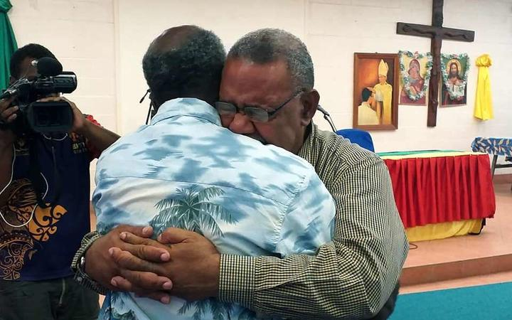 Former PNGDF Commander Jerry Singirok (right) embracing his former commanding officer Joe Pais after not seeing him for decades.