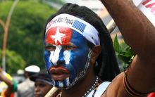 Papuan student takes part in a rally in Surabaya, East Java.