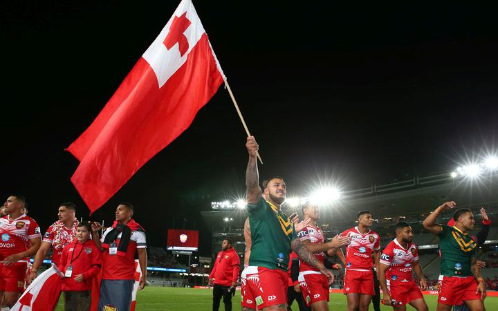Tonga celebrate their rugby league win over Australia