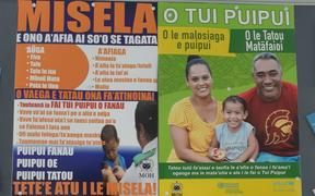 Posters warning about measles in Samoa.