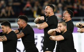 Sonny Bill Williams and team mates perform the haka against England in the Rugby World Cup.
