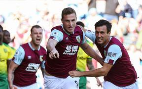 Chris Wood of Burnley runs to celebrate scoring a goal.