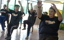 exercise programme at hospital in Bangkok. Dozens of sweaty  cops exercise to  pop songs as part of a scheme to reduce the number of overweight police in Bangkok.