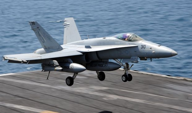 This US Navy handout photo obtained August 8, 2014 shows an F/A-18C Hornet assigned to the Valions of Strike Fighter Squadron (VFA) 15 as it prepares to land on the flight deck of the aircraft carrier USS George H.W. Bush (CVN 77)on July 29, 2014 in the Gulf.
