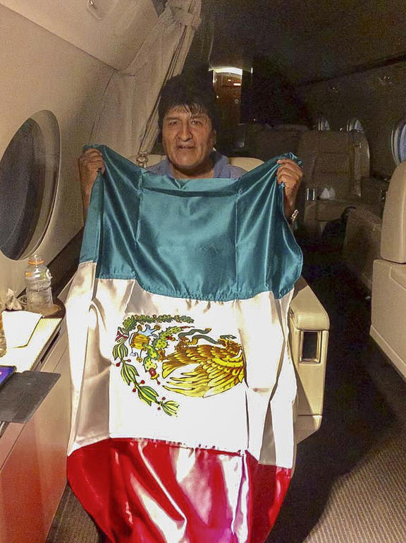 Handout picture released by the Mexican Foreign Ministry press office showing the Bolivian ex-President Evo Morales leaving Bolivia in an aircraft of the Mexican Air Force.