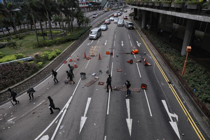 Pro-democracy barricade a road in the Central district in Hong Kong on 12 November 2019.