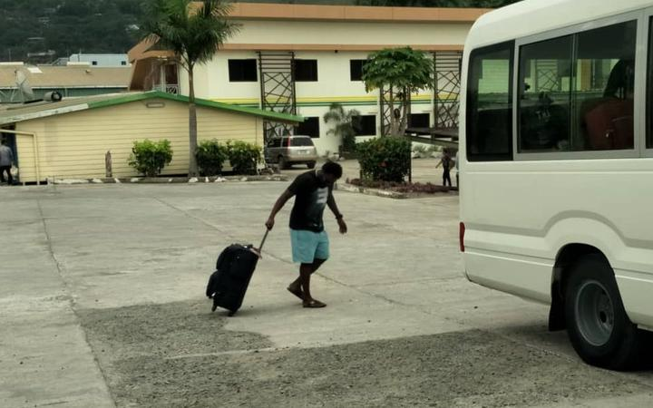 A refugee boards the bus to his new community accommodation shortly before being returned to his hotel.