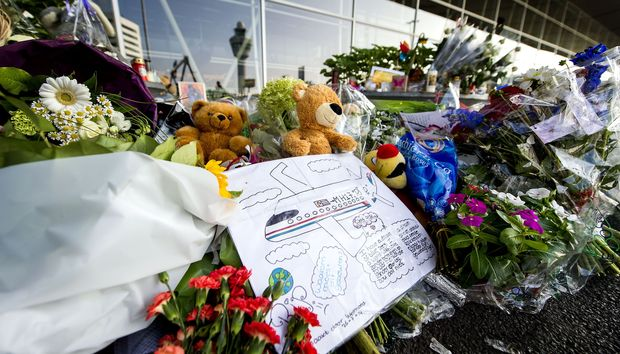 Flowers are being placed at Schiphol Airport near Amsterdam in memory of the victims of Malaysia Airlines flight MH17.
