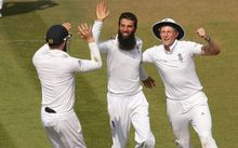 Bowler Moeen Ali celebrates with Joe Root (right) and Sam Robson (left) after Chris Jordan catches Cheteshwar Pujara during the third Investec Test Match between England and India at the Ageas Bowl, Southampton. 2014.