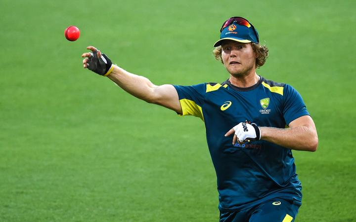 Australia's Will Pucovski throws a ball during a practice session at the Gabba Cricket Ground in Brisbane on January 22, 2019.